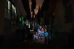 Sahro Ilmi Muhumed, 33, from Jijiga, Ethiopia, pictured with her children Adnan Abdi, 7 Elmi Noor, 2, and Mohammed Abdi, 9, in the neighbourhood of Eastleigh, Nairobi, Kenya.<br /> <br /> I left Jijijga 7 years ago because my husband and I did not come from the same tribes, my husband was Oromo and I am Somali. One time there was fighting for land between the Oromos and Ethiopians; most of the Oromos are muslim and the Ethiopians wanted to occupy their land. <br /> Unfortunately my husband was killed. I was pregnant with my second son and my in-laws started mistreating me. One day my sister-in-law pushed me and I got burnt badly with boiling water so I decided to leave. I was not even taken to the hospital I was given some tradition medicine until I got better. My in-laws felt Oromos and Somalis shouldn't marry, they mistreated me all the time, when eating, with accommodation, in every way I was mistreated. <br /> <br /> Left very early in the morning I went to Dire Dawa, I stayed there hiding for 1 week, I was afraid they would come after me and take the children from me. Then I went to Addis Ababa, when I reached there I found a Somali family and I worked as a maid for that family. Life in Addis Ababa is very expensive, I could not rent a house so when I got my first pay after 1 month I left. I went to Moyale and stayed almost 1 year. In Moyale I meet a man and got married and we had a baby boy. This man used to work between Nairobi and Moyale and he brought me to Nairobi. Here his relatives and friends shouted at him &quot;who is this woman? She is from Ethiopia you don't know people from Ethiopia they are thieves, they are dirt!&quot; He was married to another woman and his relatives accused him of spending his money on me because I have other children from another husband. So he took off and went to Libya, he wanted to cross by sea to Europe. While in Libya he called me and said &quot;I've left Nairobi and I've divorced you&quot;. He didn't tell me he was leavi