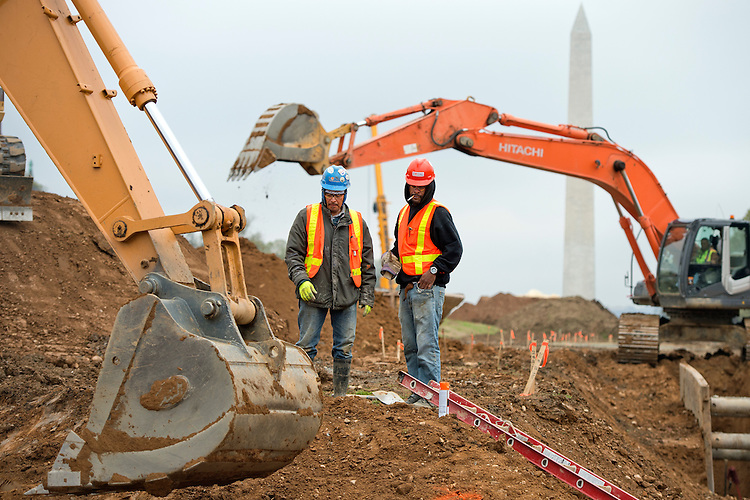 UNITED STATES - APRIL 9: Workers oversee heavy machinery as they move earth on the National Mall near 7th Street as part of an restoration project that includes installing more durable grass and improving soil drainage, April 9, 2015. The project is expected to be completed by January 2017. (Photo By Tom Williams/CQ Roll Call)
