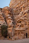 Steps and rooms carved into the sandstone in Little Petra