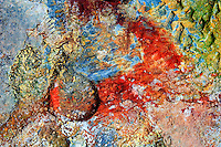 Colors of the clay in a geothermal area in Reykjanes near Reykjavik Iceland. Taken with Nikon D2X digital camera. Colors have been slightly enhanced. If looked closely then 1 krona coin and footprints can be seen to get the sense of scale.