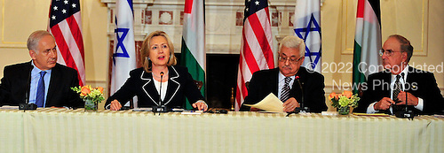 """United States Secretary of State Hillary Rodham Clinton makes closing remarks at the press event """"Relaunch of Direct Negotiations Between the Israelis and Palestinians"""" in the Benjamin Franklin Room of the U.S. Department of State on Thursday, September 2, 2010.  From left to right: Prime Minister Benjamin Netanyahu of Israel, United States Secretary of State Hillary Rodham Clinton, President Mahmoud Abbas of the Palestinian Authority, and U.S. Special Envoy to the Middle East George Mitchell..Credit: Ron Sachs / CNP.(RESTRICTION: NO New York or New Jersey Newspapers or newspapers within a 75 mile radius of New York City)"""