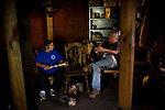 Winnemem chief and spiritual leader Caleen Sisk-Franco and headman Mark Franco sit in their prayer house in Jones Valley, Calif. March 17, 2010.