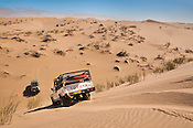 Off-road vehicles crossing sand dunes, Namib-Naukluft National Park, Namibia