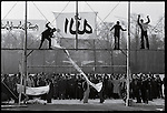 Demonstrators hanging banners at Tehran University, re-opened for the first time in  months. January 13, 1979.