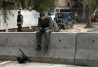 A resting riot policeman in Deraa, South of Damascus, where the uprising in Syria began. Protests against the ruling Baathist regime erupted in March 2011 and although they were peaceful government forces violently repressed them. In response to being commanded to shoot unarmed civilians large numbers of men deserted the army and formed the Free Syrian Army and an armed uprising began with major clashes taking place in early 2012.