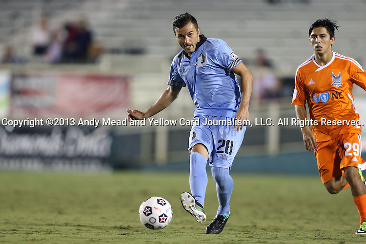 24 August 2013: Minnesota's Sinisa Ubiparipovic (BIH) (28) and Carolina's Cesar Elizondo (CRC) (29). The Carolina RailHawks played the Minnesota United FC Loons at WakeMed Stadium in Cary, NC in a 2013 North American Soccer League Fall Season game. Carolina won 1-0.