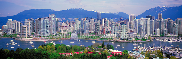 """City of Vancouver Skyline and Downtown at Yaletown and """"False Creek"""", British Columbia, Canada, in Spring.  The North Shore Mountains (Coast Mountains) rise above the City. - Panoramic View"""