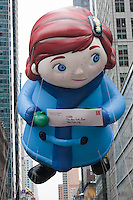 "NEW YORK - NOVEMBER 25:  The ""Yes, Virginia"" helium filled balloon floats overhead during the annual Macy's Thanksgiving Day Parade  on Thursday, November 25, 2010."