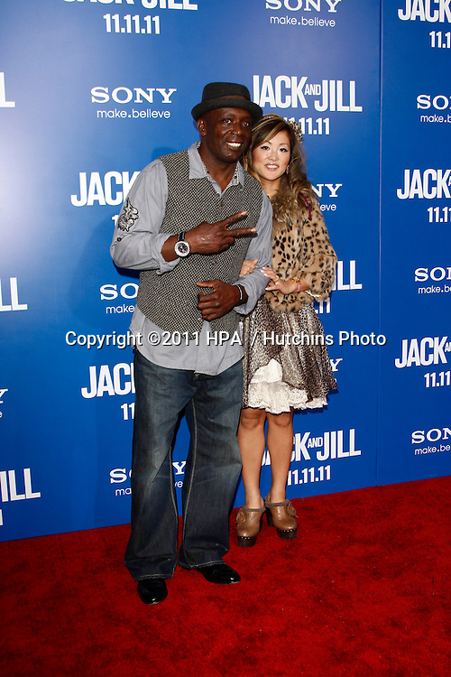 LOS ANGELES - NOV 6:  Billy Blanks, wife arrives at the Jack and Jill Premiere at Regency Village Theatre on November 6, 2011 in Westwood, CA