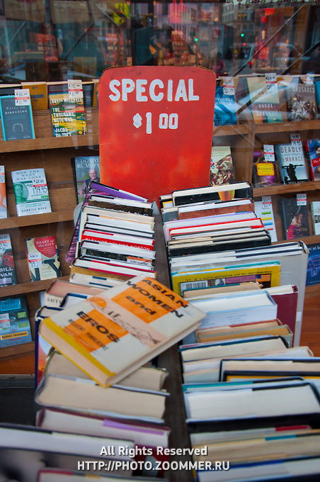 Piles of used books for sale in Strand Bookstore (Asian Women And Eros book in front)
