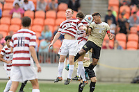 Houston, TX - Friday December 11, 2016: Jacori Hayes (8) of the Wake Forest Demon Deacons attempts to head the ball away from his goal against the Stanford Cardinal at the NCAA Men's Soccer Finals at BBVA Compass Stadium in Houston Texas.
