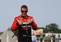 Aug. 18, 2013; Brainerd, MN, USA: NHRA top fuel dragster driver Clay Millican prior to the Lucas Oil Nationals at Brainerd International Raceway. Mandatory Credit: Mark J. Rebilas-