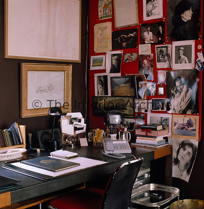 A series of family and other photographs displayed on a pinboard next to Lord Snowdon's desk