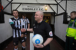 Chorley 2 Altrincham 0, 21/01/2017. Victory Park, National League North. The match referee shaking hands with home team captain Dale Whitham in the tunnel at Victory Park, before Chorley played Altrincham in a Vanarama National League North fixture. Chorley were founded in 1883 and moved into their present ground in 1920. The match was won by the home team by 2-0, watched by an above-average attendance of 1127. Photo by Colin McPherson.