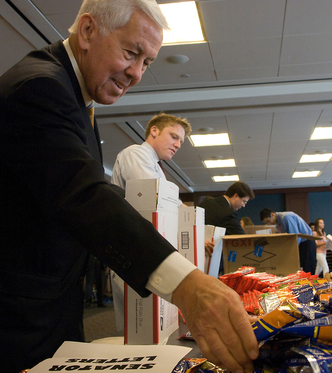 Sen. Dick Lugar, R-Ind.; helps to assemble 400 gift packages for the Indiana National Guard members serving in Iraq and Afghanistan. The event was held at the Home Depot Washington Office at 101 Constitution Ave., in Washington, D.C.