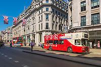 Tour bus makes its way past the shops
