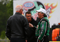 May 19, 2014; Commerce, GA, USA; NHRA top fuel driver Clay Millican (center) and funny car driver John Force (right) talk with NHRA official Graham Light during the Southern Nationals at Atlanta Dragway. Mandatory Credit: Mark J. Rebilas-USA TODAY Sports