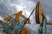 China National Petroleum Corp.'s 'nodding donkeys' oil pumps during a storm in Daqing, Heilongjiang province, China, on July 13, 2006. China National Petroleum Corp is the mother company of PetroChina. Photo by Servais Mont/Pictobank