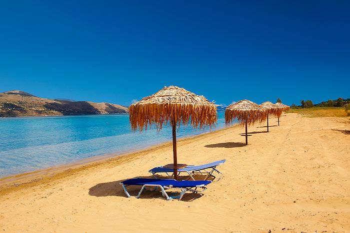 Beach & sunbeds on Agrostoli Bay near Lixouri, Kefalonia, Ionian Islands, Greece.