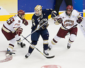 Matt Price (BC 25), Ryan Thang (Notre Dame 9), Benn Ferriero (BC 21) - The Boston College Eagles won the NCAA D1 national championship by defeating the University of Notre Dame Fighting Irish 4-1 in the final of the 2008 Frozen Four at the Pepsi Center in Denver, Colorado on Saturday, April 12, 2008.