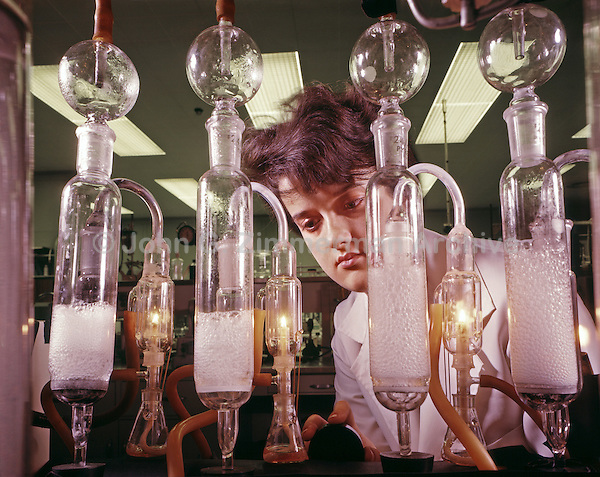 Janet Mackie, one of few female engineers in the automotive industry, measures the sulfur content of a high-octane fuel. Ford Motor Company, Dearborn Michigan, 1966. Photo by John G. Zimmerman.