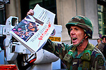 United States, New York, November 11, 2011..A member of Occupy wall street disguised as soldier shout slogans to support the occupy movement while members and veterans of military forces take part in the Veterans Day Parade in New York, November 11, 2011. VIEWpress / Eduardo Munoz Alvarez..The Veterans Day Parade has been organized in New York since 1929. Over 25,000 people participate in the Veterans Day Parade in New York City each year, making it the largest in the nation..Local Media Report.