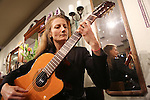 Guests enjoy wine and live entertainment at the Nature Gallery in downtown Los Altos during First Friday Dec. 7.