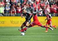 05 May 2012: D.C. United forward Maicon Santos #29 and Toronto FC defender Doneil Henry #4 in action during an MLS game between DC United and Toronto FC at BMO Field in Toronto..D.C. United won 2-0.