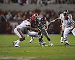 Alabama running back Mark Ingram (22) is tackled by Ole Miss cornerback Marcus Temple (4) and Ole Miss linebacker Allen Walker (9)  at Bryant-Denny Stadium in Tuscaloosa, Ala.  on Saturday, October 16, 2010. Alabama won 23-10.