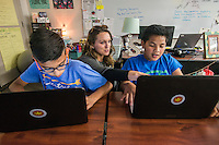 NWA Democrat-Gazette/ANTHONY REYES @NWATONYR<br /> Natalie Sneed, ELA teacher at Hellstern Middle School, helps Hency Bungitak (right), 11, and Diego Soto, 12, with a question on an online problem Monday, Feb. 27, 2017 during an after school study session at the school in Springdale. On this day, they were getting started on their homework list for the week.