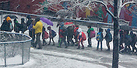 Students are arrive at Public School 33 in the Chelsea neighborhood of New York on Thursday, March 5, 2015. A snow system arriving in New York and the tri-state area is expected to deposit up to 6 inches of the powdery stuff. Schools in the city are open. (© Richard B. Levine)