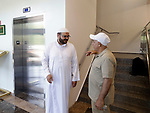 """Waterbury, CT- 19 May 2017-051917CM01-  Fathi Omer, left, greets Senan Ali of Waterbury during the grand opening of the Masjid Al Mostafa mosque in Waterbury on Friday.  """"It's a blessing from God, to have a nice beautiful place of worship.  It's wonderful."""" said Naveed Khan, vice chairman of the Islamic American Society of Connecticut.  The days events featured a private prayer service, then a celebration with local dignities and members of the community.  Christopher Massa Republican-American"""