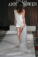Model walks runway in a Triangle Below Canal wedding dress by Anne Bowen, for the Anne Bowen Bridal Spring 2012 runway show.