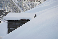 Alpine House covered with seasons first snow of 2006, Gimmelwald, Bernese Alps, Switzerland