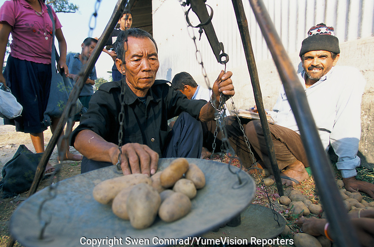Under UNHCR protection, the life of 135000 Bhutanese refugees in one of the 7 camp near Damak, Nepal. The weekly food distibutuion for a Bhutanese refugee family..-The full text reportage is available on request in Word format