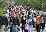 Refugees and migrants walk through the Hungarian town of Hegyeshalom on their way to the border where they will cross into Austria. Hundreds of thousands of refugees and migrants flowed through Hungary in 2015, on their way from Syria, Iraq and other countries to western Europe.