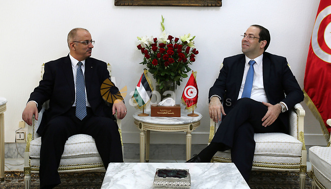 Palestinian Prime Minister Rami Hamdallah meets with Tunisian Prime Minister Youssef Chahed in Tunis, Tunisia on April 7, 2017. Photo by Prime Minister Office