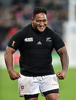 Halani Aulika of Tonga shows off the New Zealand jersey he swapped with his opposite number after the match. Rugby World Cup Pool C match between New Zealand and Tonga on October 9, 2015 at St James' Park in Newcastle, England. Photo by: Patrick Khachfe / Onside Images