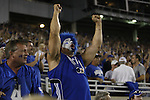 A UK fan celebrates the first touchdown to give UK a 7-0 lead during the first half of UK's home game against Auburn, Oct. 9, 2010. Photo by Brandon Goodwin| Staff