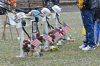 Mourners stand at the memorial on the county courthouse lawn in Phillipi, WV Friday, Jan. 6, 2006, for four of the 12 miners killed in the Sago mine explosion. (Gary Gardiner/EyePush Newsphotos)<br />
