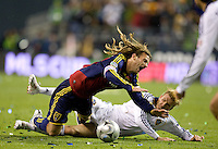 Real Salt Lake's Kyle Beckerman is taken down by David Beckham during a Real Salt Lake defeat of the Los Angles Galaxy 5-4 on penalty kicks to win the 2009 MLS Cup at Qwest Field, Sunday, Nov. 22, 2009.