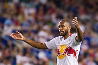 Thierry Henry (14) of the New York Red Bulls encourages the fans. The New York Red Bulls defeated the Houston Dynamo 2-0 during a Major League Soccer (MLS) match at Red Bull Arena in Harrison, NJ, on August 10, 2012.