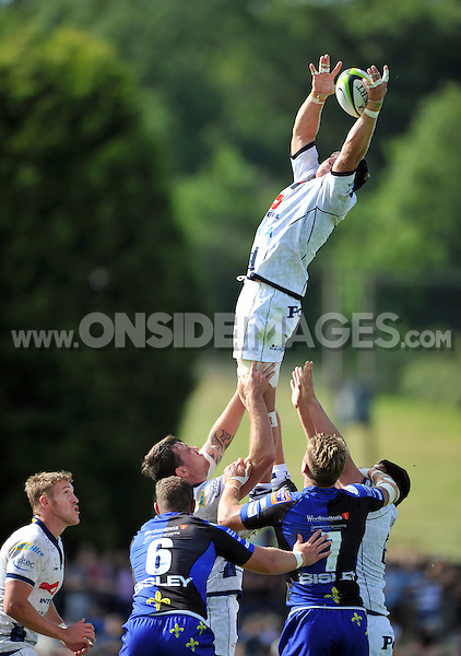 Ross Rennie rises high to win lineout ball. Pre-season friendly match, between Bristol Rugby and Newport Gwent Dragons on August 17, 2014 at the Cribbs Causeway Ground in Bristol, England. Photo by: Patrick Khachfe / JMP
