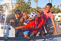 Kids from the Police Activities League (PAL) play on the Harbor Patrol Zodiac during the 29th Anniversary of National Night Out at the Santa Monica Civic Auditorium parking lot on Tuesday, August 7, 2012.