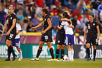 14 MAY 2011: USA Women's National Team forward Lauren Cheney (12),  forward Abby Wambach (20) midfielder Lori Lindsey (16) and defender Ali Krieger (11) after the International Friendly soccer match between Japan WNT vs USA WNT at Crew Stadium in Columbus, Ohio.