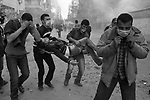 Egyptian protestors evacuate a wounded colleague after he was injured by the police during ongoing demonstrations November 20, 2011 near Tahrir square in central Cairo, Egypt.  Protestors demanding the transition of power from military to civilian control clashed with Egyptian security forces for a second straight day in central Cairo, with hundreds injured and at least 11 protestors killed.  (Photo by Scott Nelson)