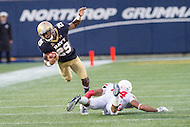 Annapolis, MD - OCT 8, 2016: Navy Midshipmen running back Darryl Bonner (29) goes airborne after being tripped up by Houston Cougars cornerback Jeremy Winchester (24) during game between Houston and Navy at Navy-Marine Corps Memorial Stadium Annapolis, MD. The Midshipmen upset #6 Houston 46-40. (Photo by Phil Peters/Media Images International)