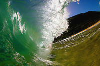 A barrel breaks at Gas Chambers at Sandy Beach on Oahu, Hawaii. Sandys is known for its explosive shorebreak, and is known to break necks and spines. The wave often throws further out than it is tall.