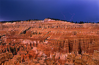 370750061 a lightning storm over the silent city hoodoos creates dramatic skies and lighting on the hoodoos in bryce canyon national park utah