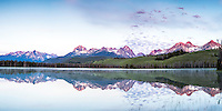 Sunrise over the Sawtooth Range. Early morning reflections at Little Redfish Lake. <br />